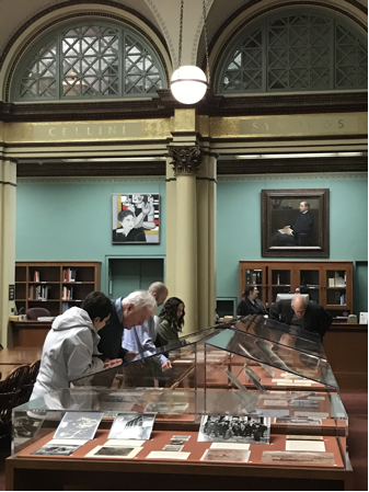 Viewers enjoying the exhibition in the Ryerson & Burnham Libraries,  photo by Autumn Mather.